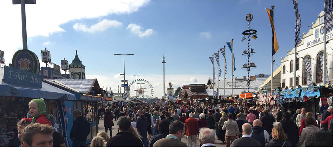 Oktoberfest's main thoroughfare with the giant Ferris Wheel in the background